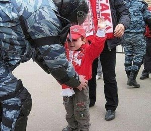An Azerbaijani infant is being searched upon entry to football stadium